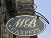 M & B Carpets sign